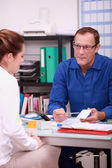 Specialist in electricity with customer — Stock Photo