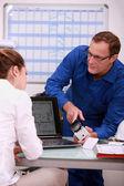 Technician explaining to assistant — Stock Photo