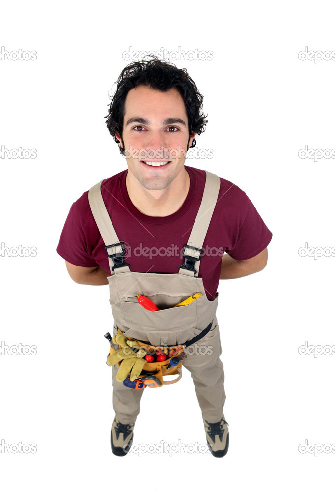 Young handyman facing the camera  Stock Photo #9670286
