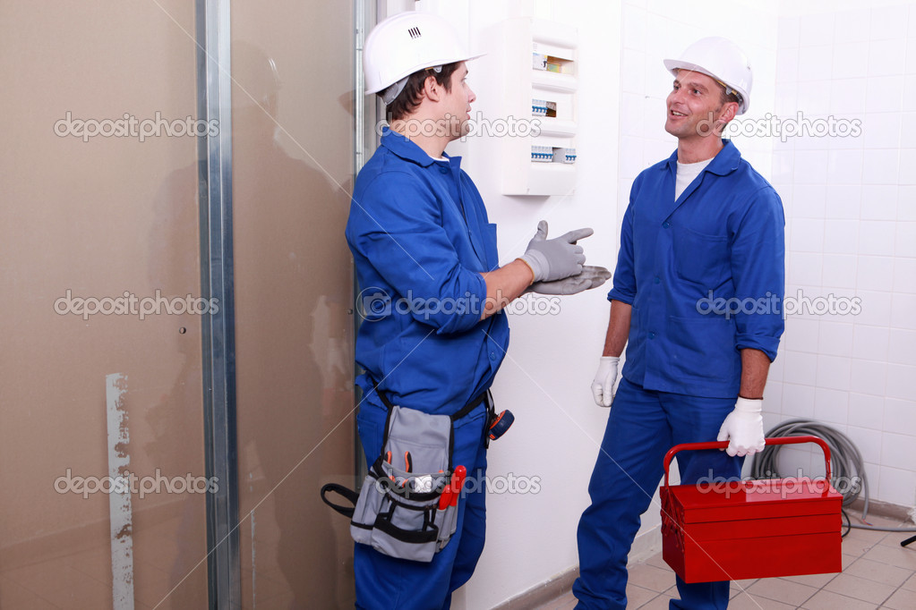 Electricians in front of electrical panel  Stock Photo #9672241
