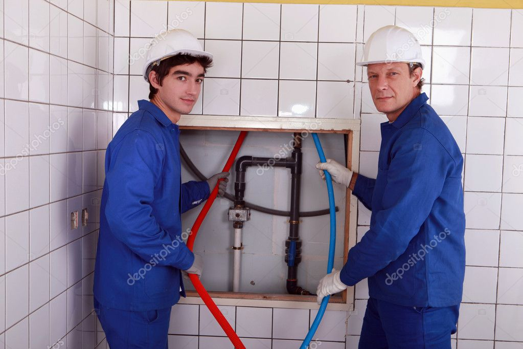 Team of plumbers  Stock Photo #9673316