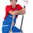 Decorator standing on a ladder — Stock Photo #9680998