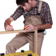 Man measuring wood frame - Lizenzfreies Foto