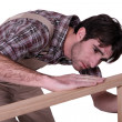 Stock Photo: Joiner checking his work