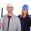 Painter with roller and female electrician — Stock Photo #9681516