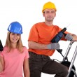 Man and woman with drills — Stock Photo #9681538