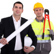 Stock Photo: Architect and foremworking hand in hand