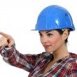 Happy craftswoman pointing — Stock Photo