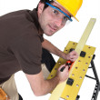 Stock Photo: Woodworker using plane