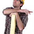 Woodworker thinking and calculating — Stock Photo #9682464