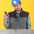 Worker readin a text message — Stock Photo