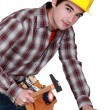 Man tapping in a nail - Stock Photo