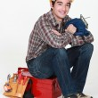 Young craftsmsitting on tool box — Stock Photo #9683135