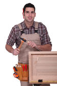 Carpenter with hammer and chisel — Stock Photo