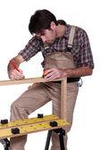 Man measuring wood frame — Stock Photo