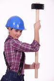Tradeswoman holding a mallet — Stock Photo