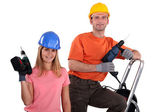 Man and woman with drills — Stock Photo