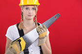Woman with a saw — Stock Photo