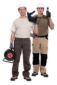 Two men holding power drills — Stock Photo