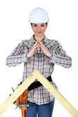 Female builder with a timber apex — Stock Photo