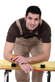 Man posing with his workbench — Stock Photo