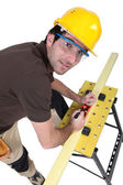Woodworker using plane — Stock Photo