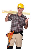 Satisfied building worker on white background — Stock Photo