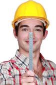Portrait of craftsman holding ruler — Stock Photo