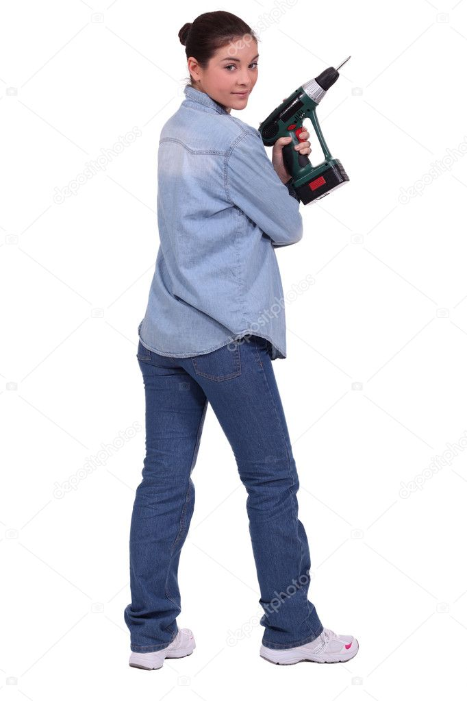 Woman holding a driller. — Stock Photo #9681398