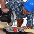 Tradesman using a mitre saw — Stock Photo