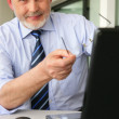 Man pointing to his laptop — Stock Photo