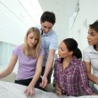 Architects consulting a blueprint — Stock Photo #9702325