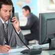 Executive on phone in ffice — Stock Photo #9702415