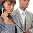 Stok fotoğraf: Business couple making important call