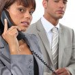 Foto de Stock  : Business couple making important call