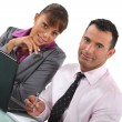 Business couple with a laptop — Stock Photo