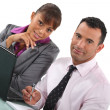 Business couple with a laptop - Stock Photo