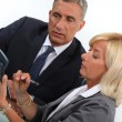 Business professionals calculating costs — Stock Photo