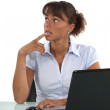 Worried looking office worker with a laptop — Stock Photo #9704650