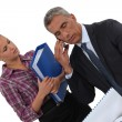 Stock Photo: Boss and assistant working closely together