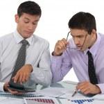 Businessmen scrutinizing financial results — Stock Photo #9704958