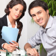 Female architect in office with client — Stock Photo #9705273