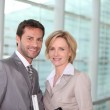 Business couple smiling — Stock Photo #9705352
