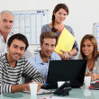 class and teacher gatherd around laptop — Stock Photo