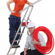 Stock Photo: Two plumbers working together