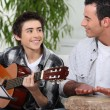 Father and son playing music together — Stock Photo #9706838