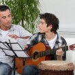 Father and son with a guitar — Stockfoto