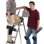 Tiler and apprentice on white background — Stock Photo