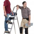 Two tilers pausing to look at something — Stock Photo #9706888