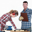 Couple working at a workbench — Stock Photo #9706998